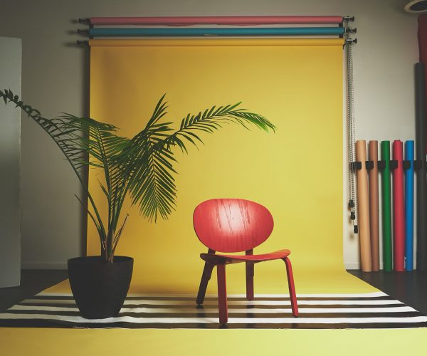 Yellow Backdrop & Red Chair